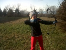 shooting bow in red pants