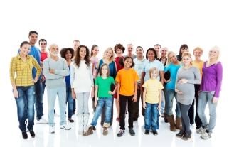 Cheerful mixed age group of people standing.